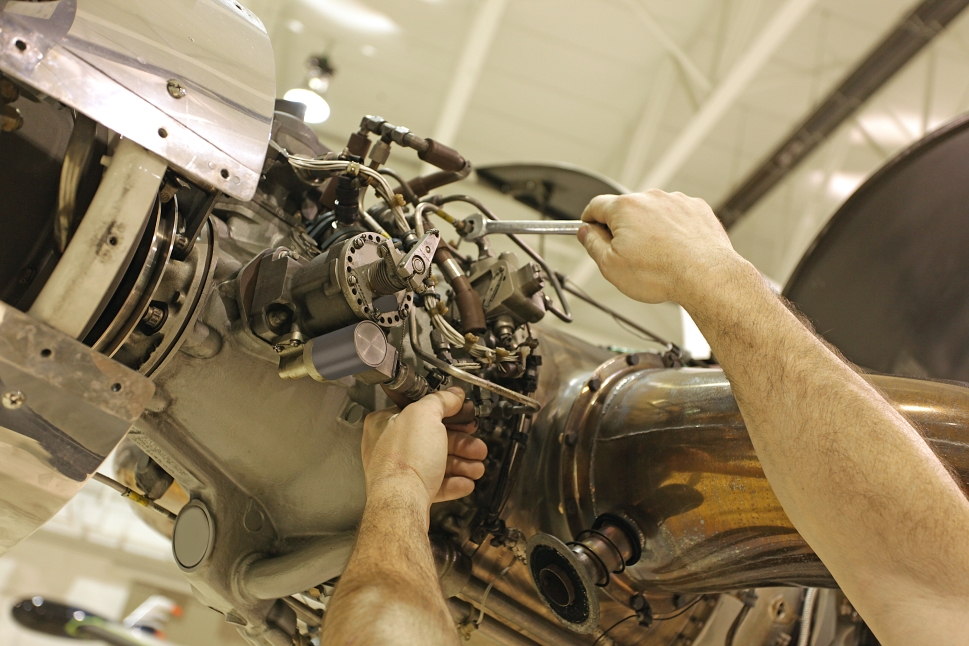 Turboprop Engine Being Worked on by Mechanic