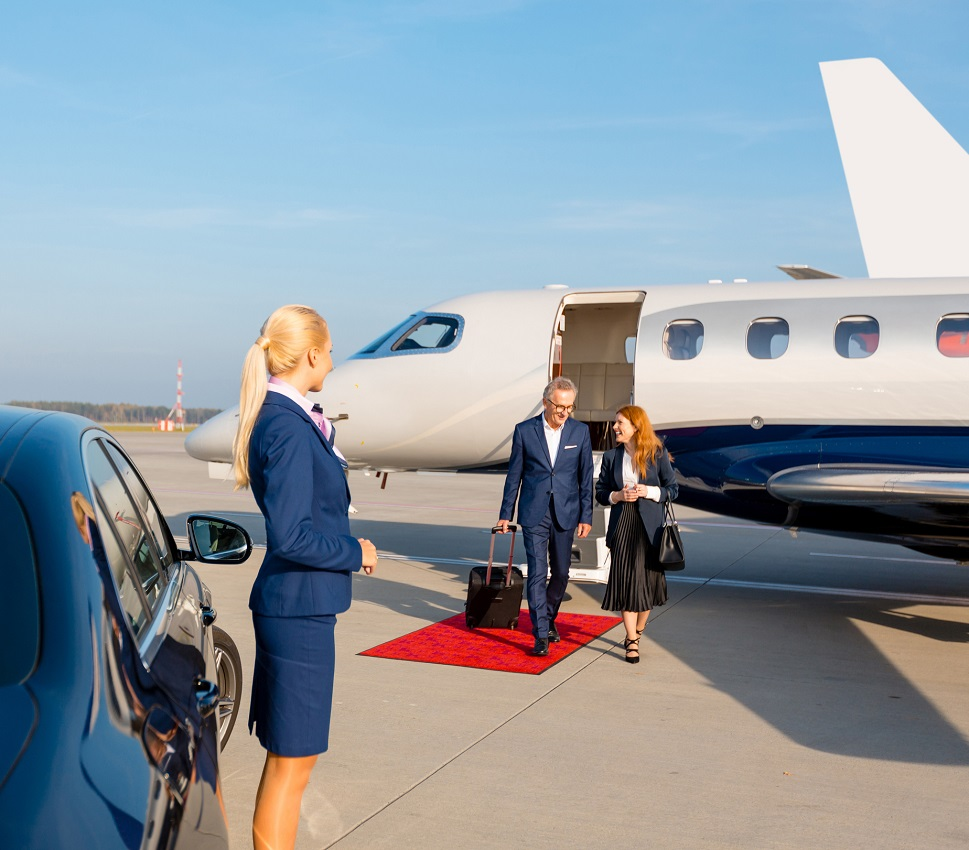Business passengers exiting a private jet