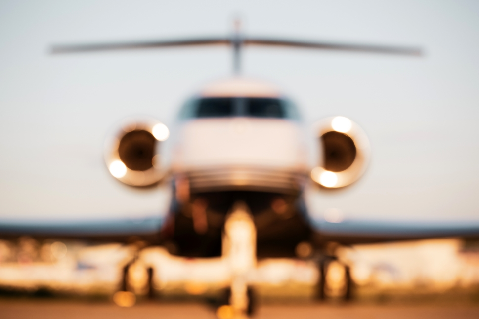 Private jet on airport ramp blurry effect