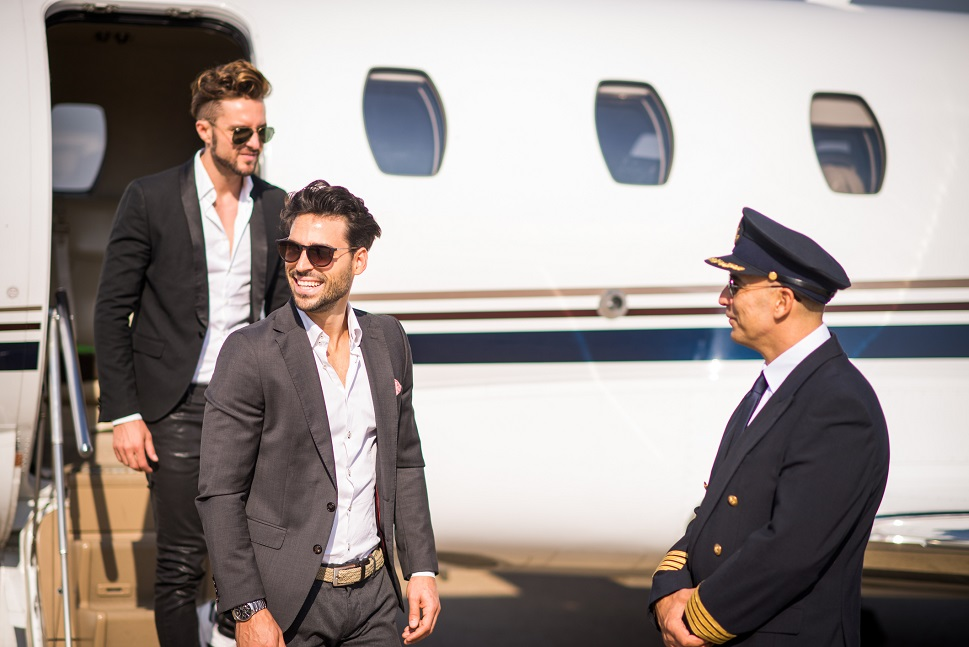 Private jet passengers exit airplane