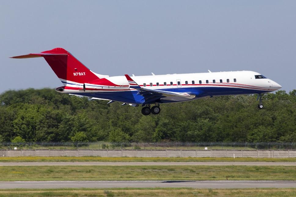 A Bombardier Global private jet landing at Farnborough Airport