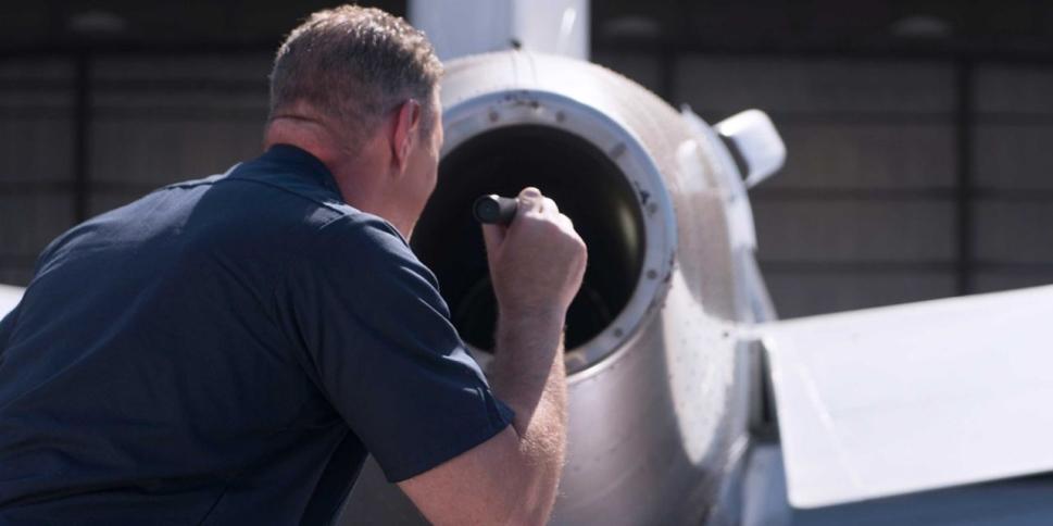 Engineer checking jet engine
