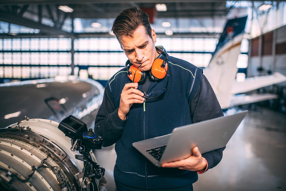 An aircraft mechanic studies data from a private jet powerplant