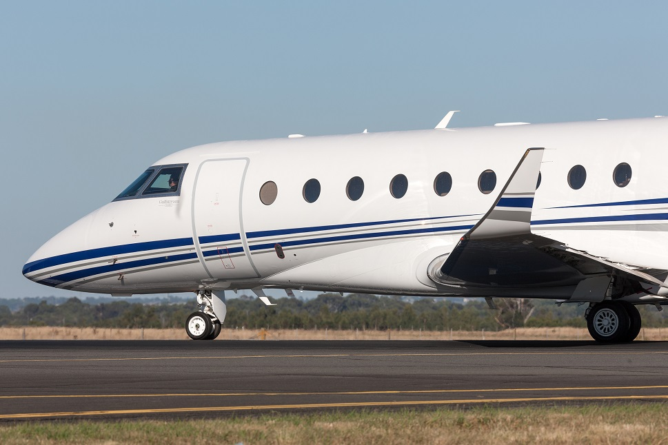 Private Gulfstream Jet taxis into position at airport