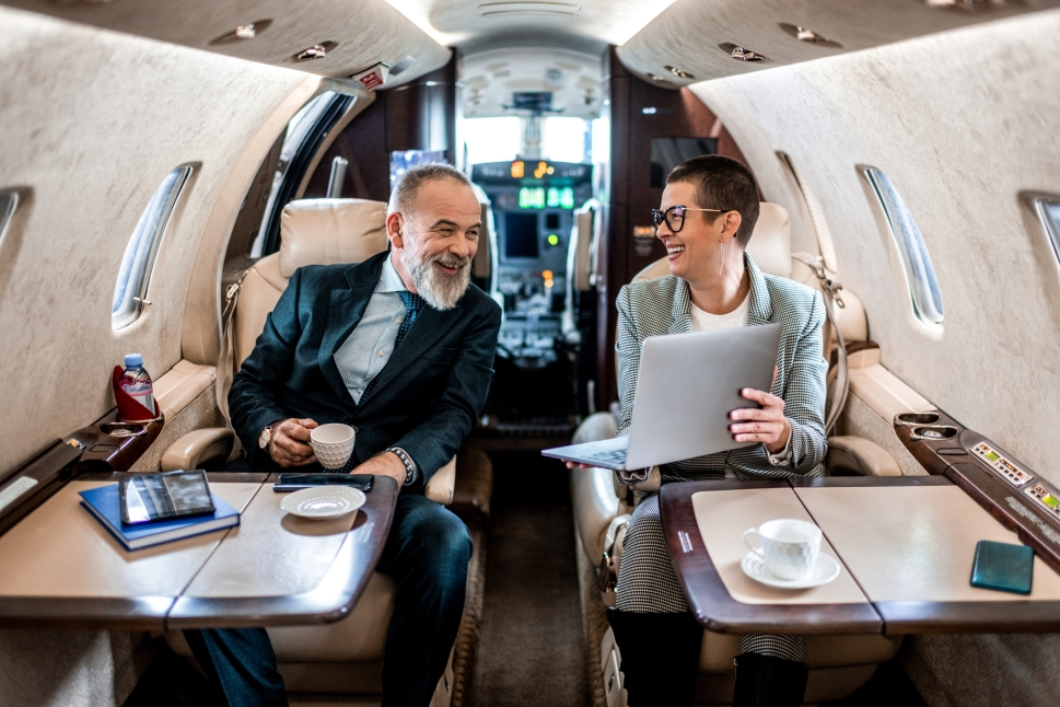 Busy executives working on a Cessna Citation jet