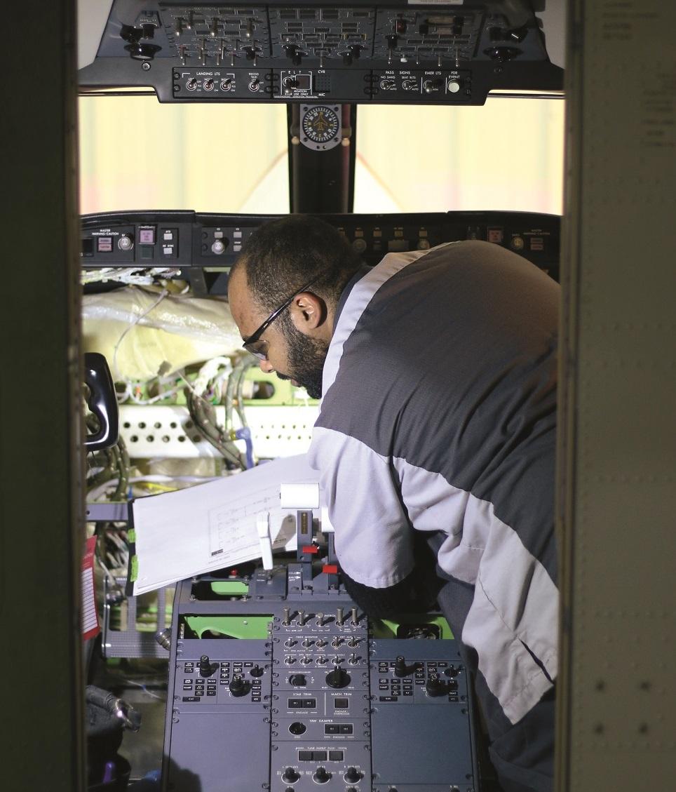 A Duncan Aviation technician installs a flight panel retrofit