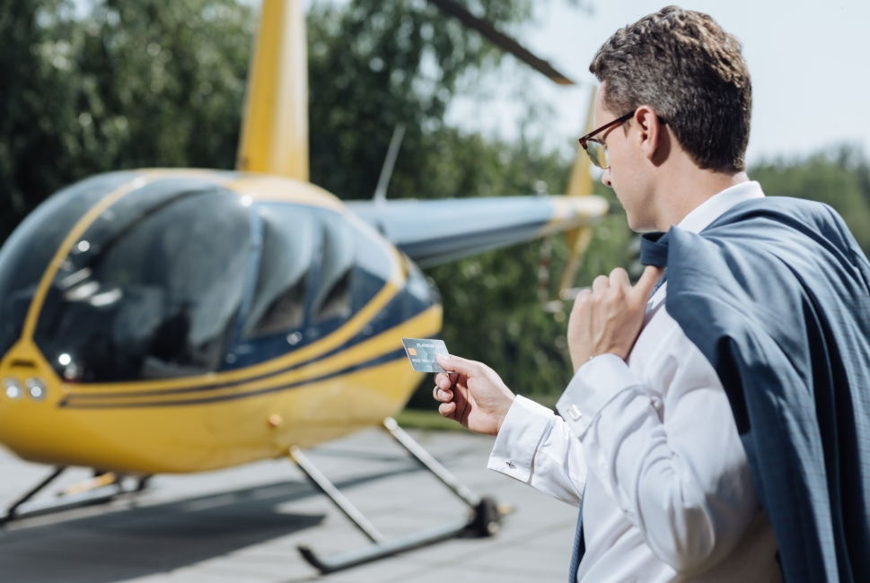Helicopter buyer with credit card in hand