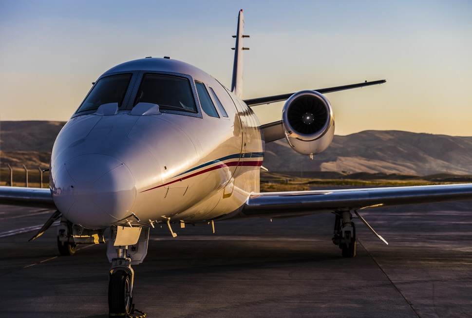 A Cessna Citation Private Jet parked with mountain backdrop