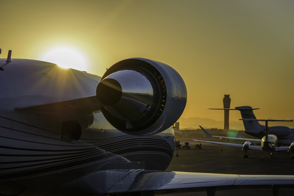 Parked business aircraft at sunset