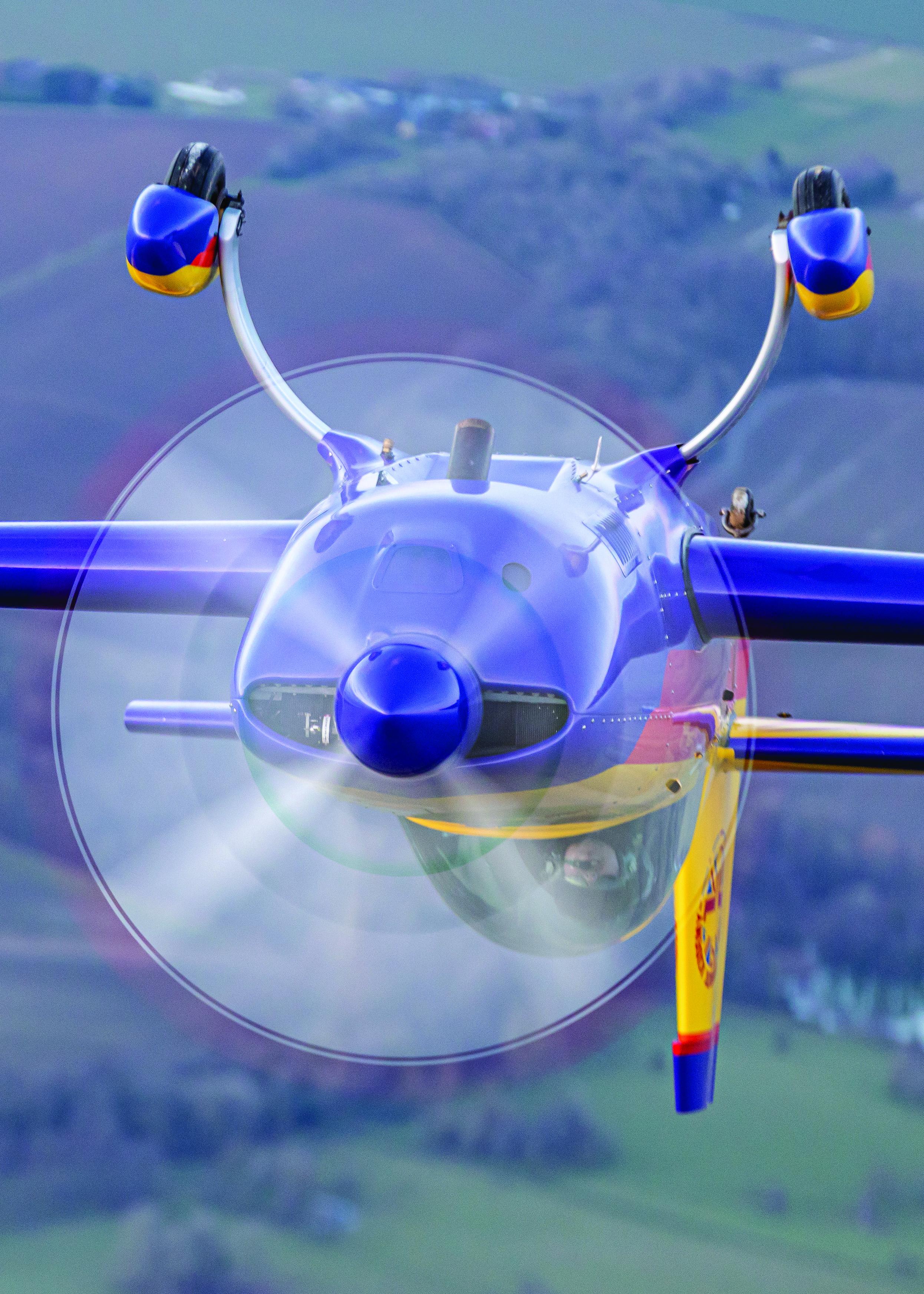 Aerobatic aircraft upside down in air