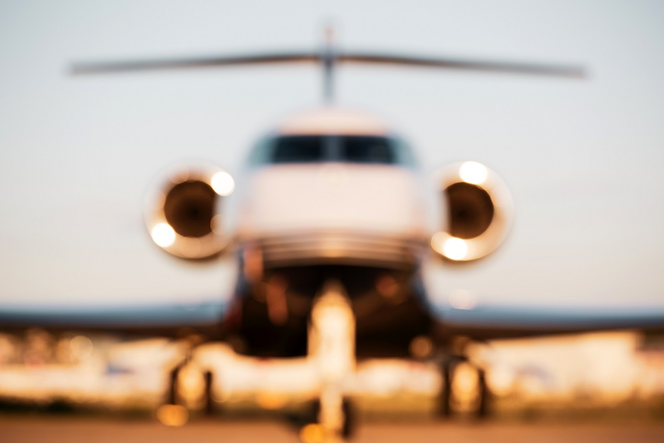 Front view of a private jet blurred effect