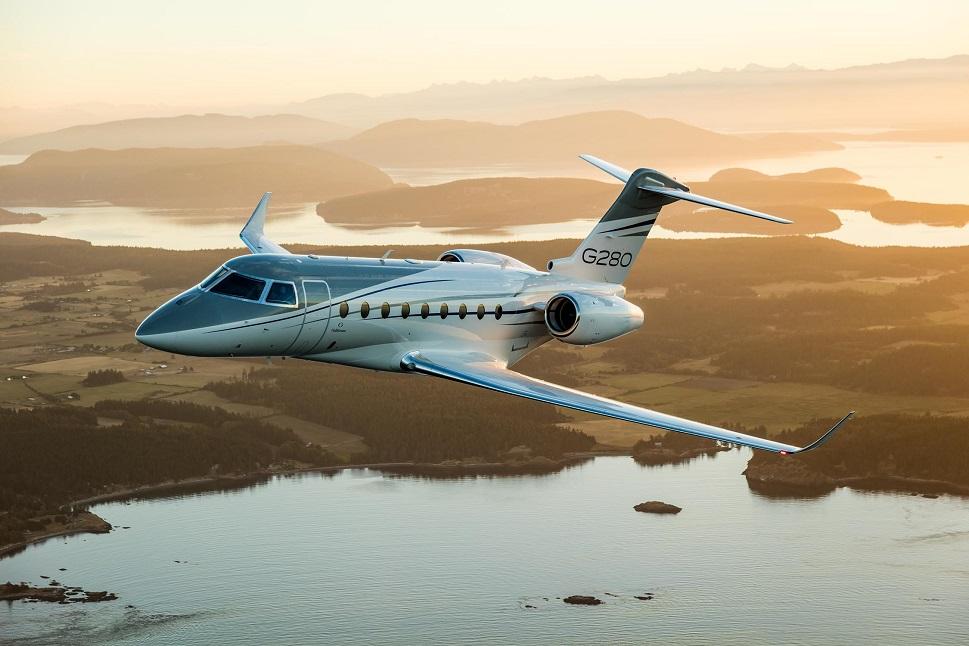 Gulfstream G280 Mid-Size jet flies at sunrise