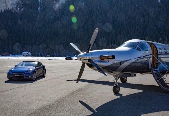 Tesla and Pilatus PC-12 on the ground