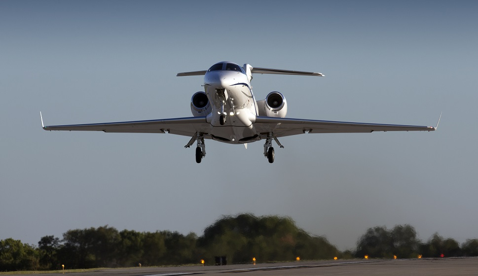 A Cessna Citation private jet comes in to land