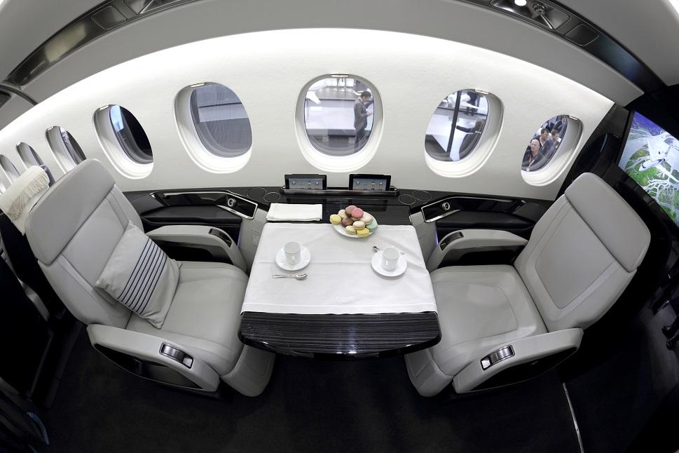 Overhead photo in a Dassault Falcon business jet cabin