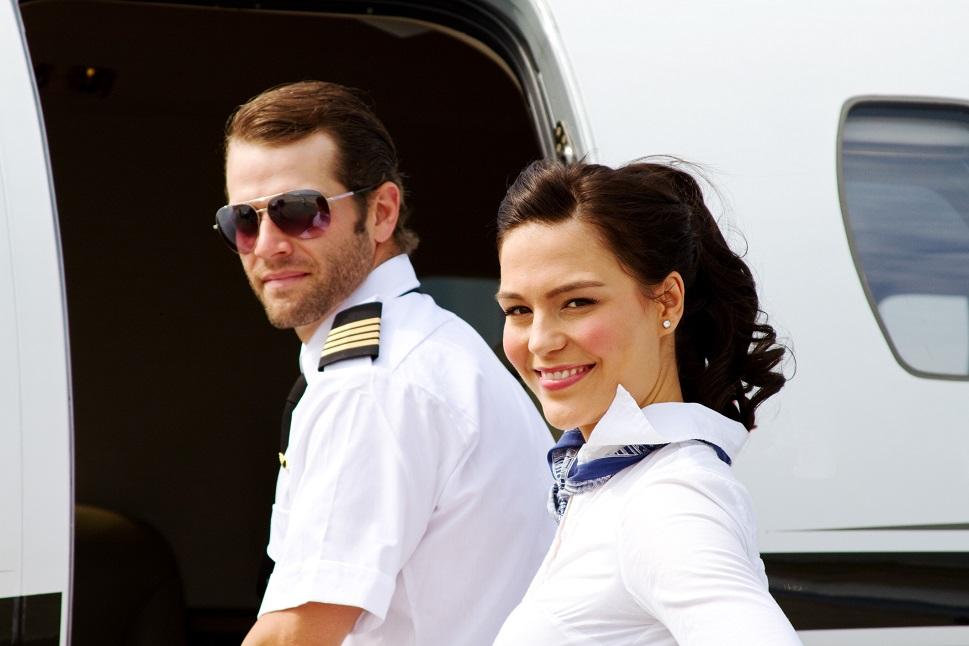 Pilot and flight attendant board a Cessna Citation private jet
