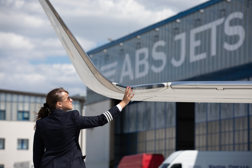 An ABS Jets crew member completes a walk around inspection of a private jet
