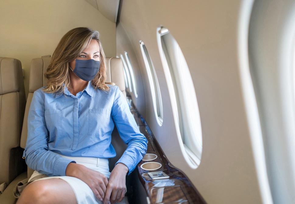 Private jet passenger wears a facemask in-flight
