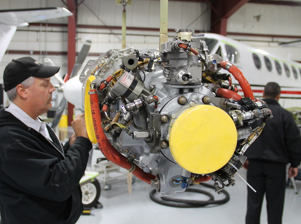 MRO worker maintaining a Pratt & Whitney PT6A engine