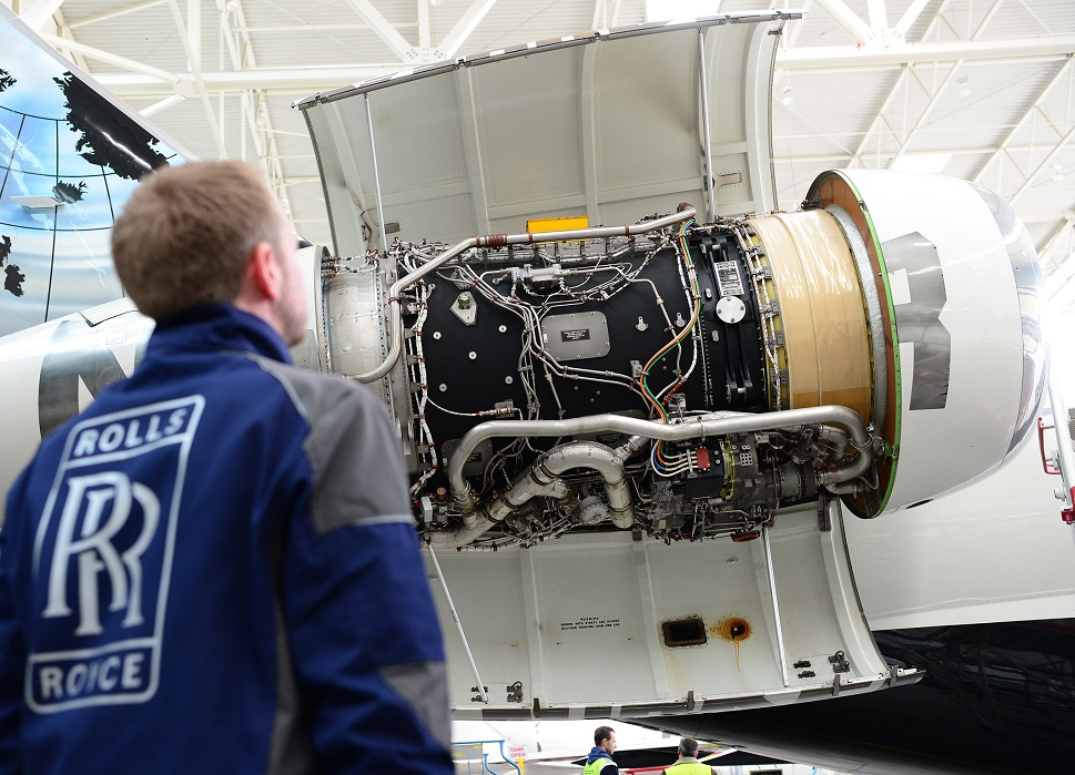 Rolls-Royce engine technician inspects a private jet engine nacelle