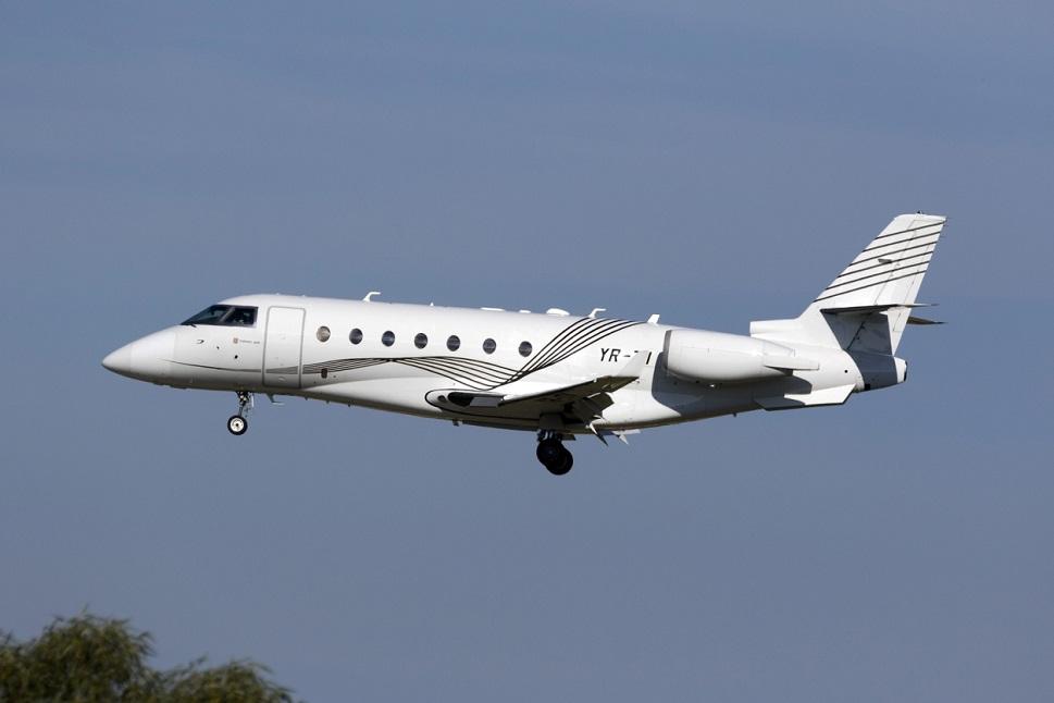Gulfstream G200 super mid-size private jet in flight