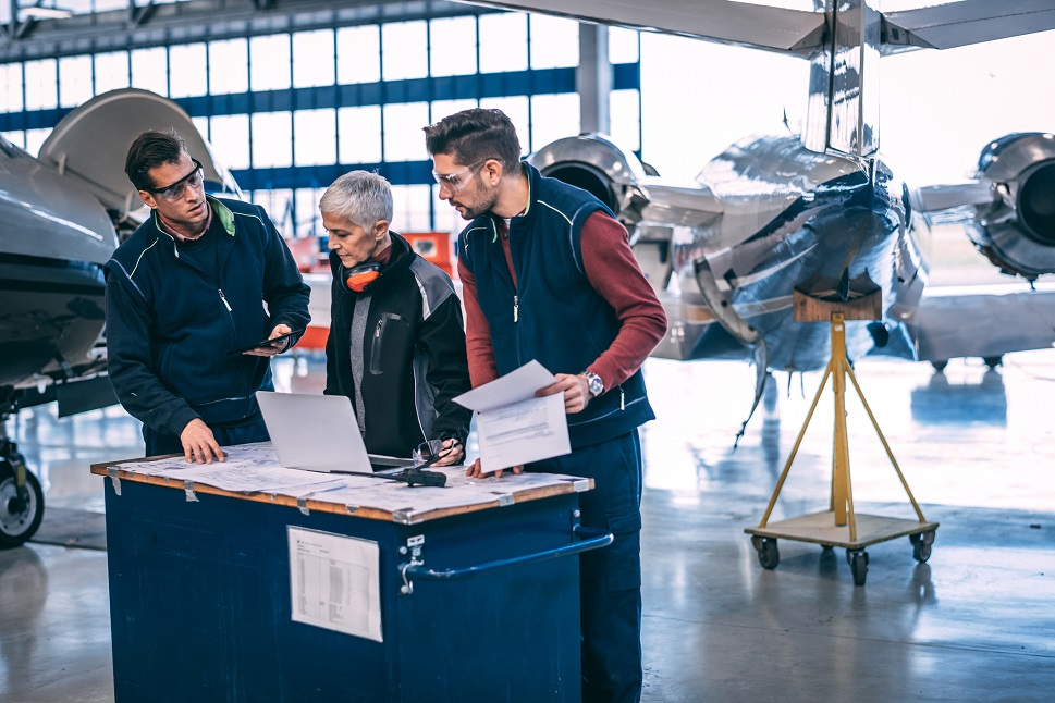 Aircraft mechanics discuss an aircraft's digital maintenance diagnostics